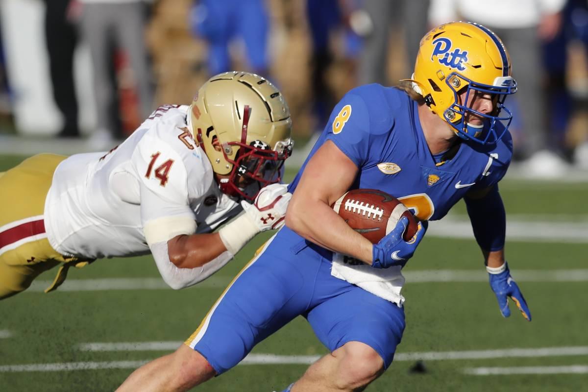 Pittsburgh quarterback Kenny Pickett (8) evades Boston College linebacker Max Richardson during ...