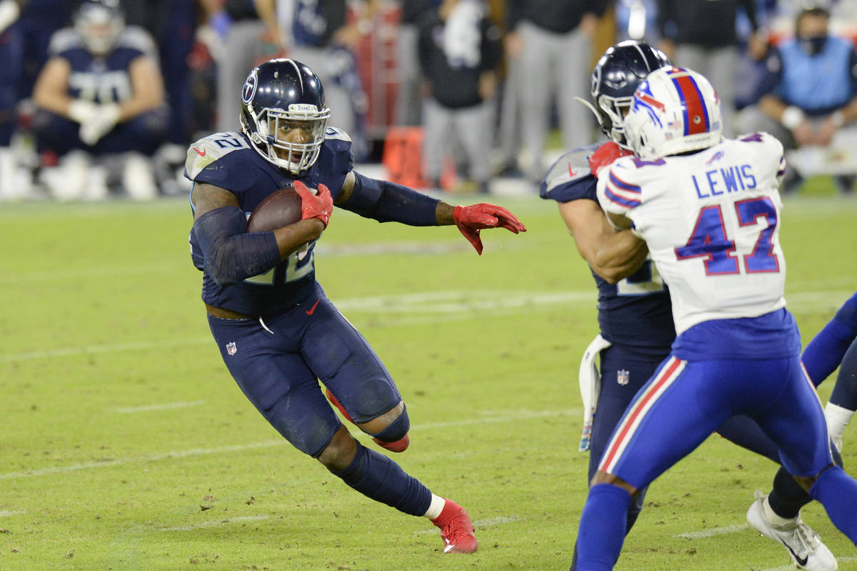 Tennessee Titans running back Derrick Henry (22) carries the ball as Buffalo Bills cornerback C ...