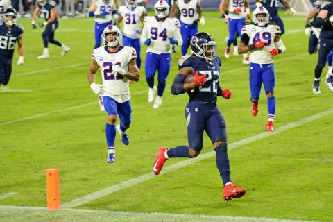 Tennessee Titans running back Derrick Henry (22) scores a touchdown on a 9-yard run against the ...