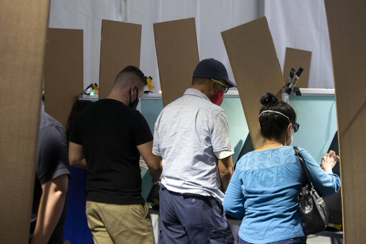 Voters cast their ballots at the Boulevard Mall early voting location on Saturday, Oct. 17, 202 ...
