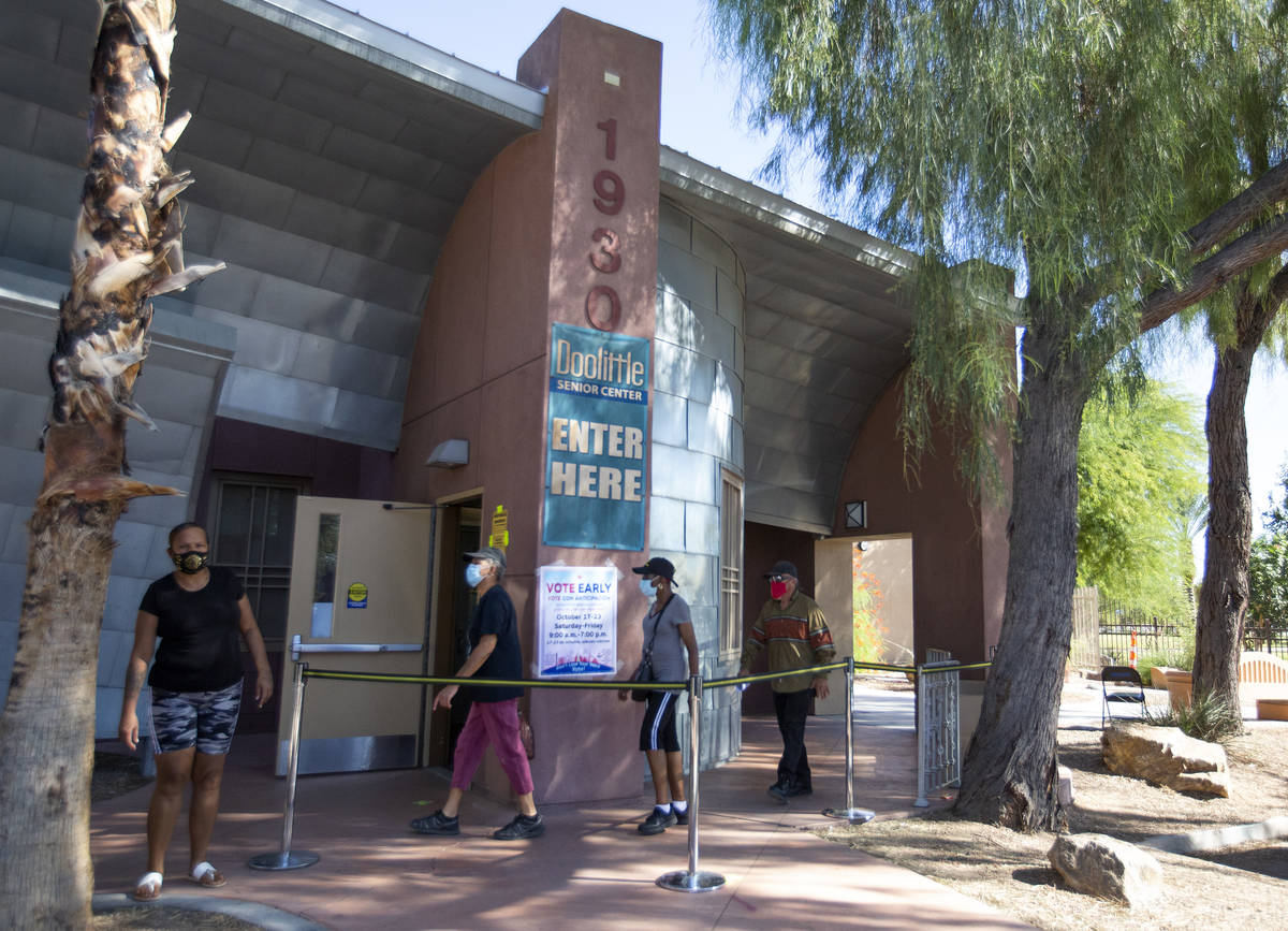 Early voters walk into a lineless Doolittle Community Center on Saturday, Oct. 17, 2020, in Las ...