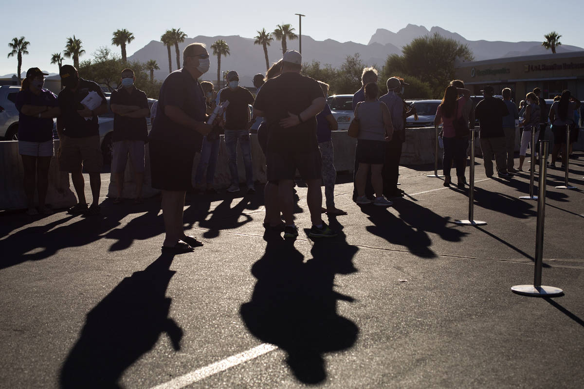 Voters wait in line at the early voting location in the parking lot of Centennial Center Home D ...