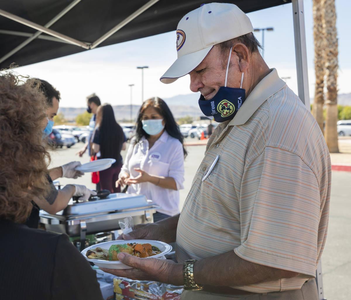 Arturo Cota, 75, of Las Vegas, eats a free meal provided at the Desert Breeze Community Center ...