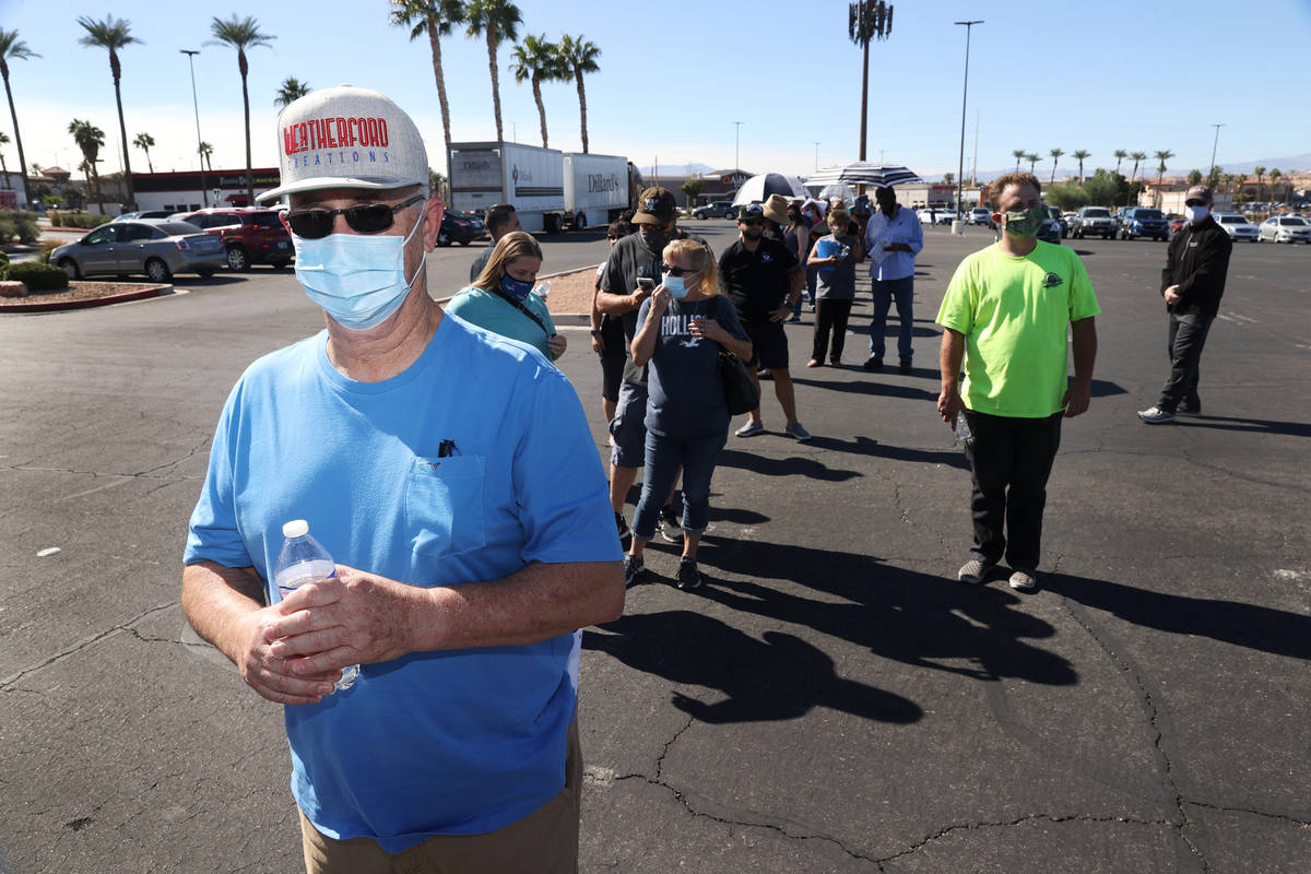 Harvey Weatherford of Henderson waits in line to cast his vote at the Galleria at Sunset pollin ...