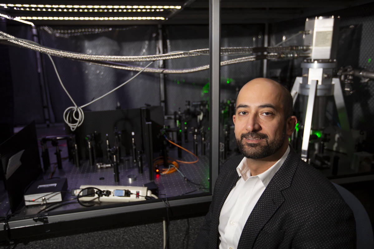 Ashkan Salamat, assistant professor of physics and astronomy at UNLV, poses for a portrait in h ...