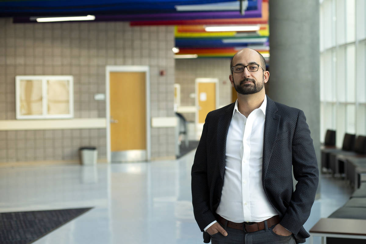 Ashkan Salamat, assistant professor of physics and astronomy at UNLV, poses for a portrait outs ...