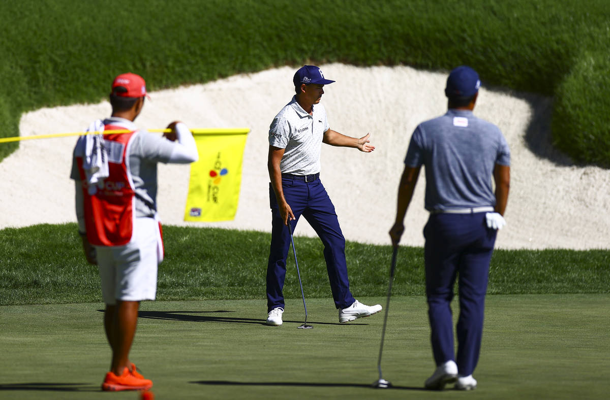 Rickie Fowler reacts after putting on the 18th green during the second round of the CJ Cup at t ...