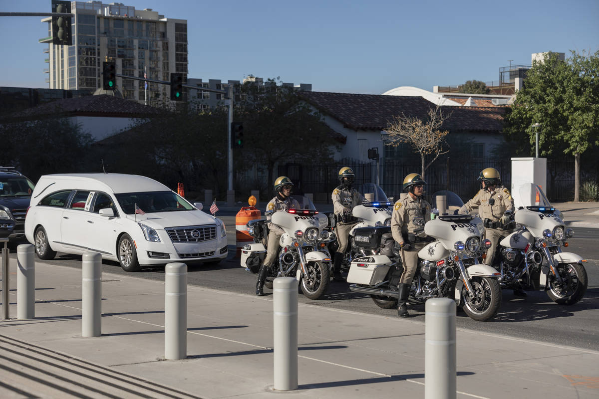A police-escorted motorcade arrive at the front of the Lloyd D. George Federal Courthouse to ho ...