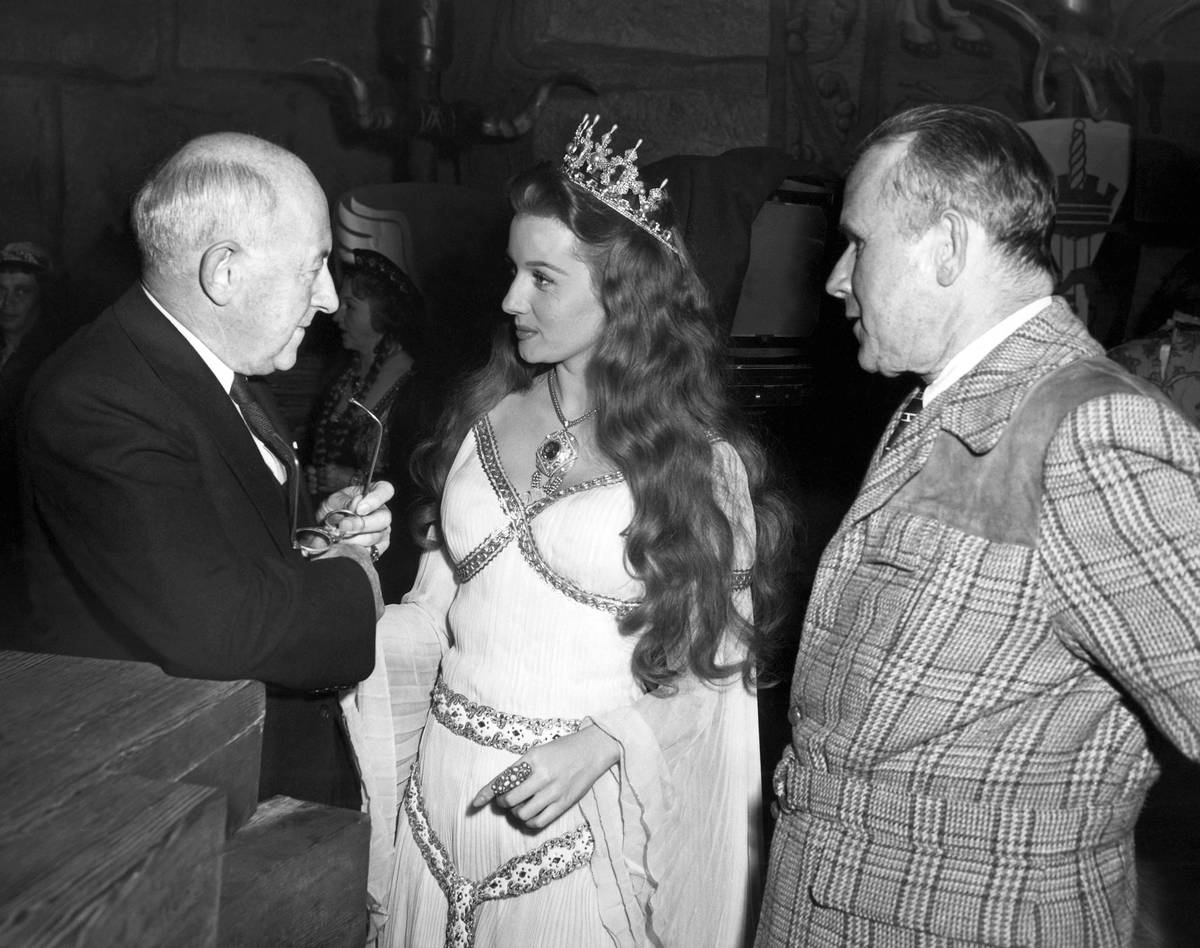 FILE - In this Dec. 16, 1947 file photo, Producer- director Cecil B. DeMille, left, gives actre ...