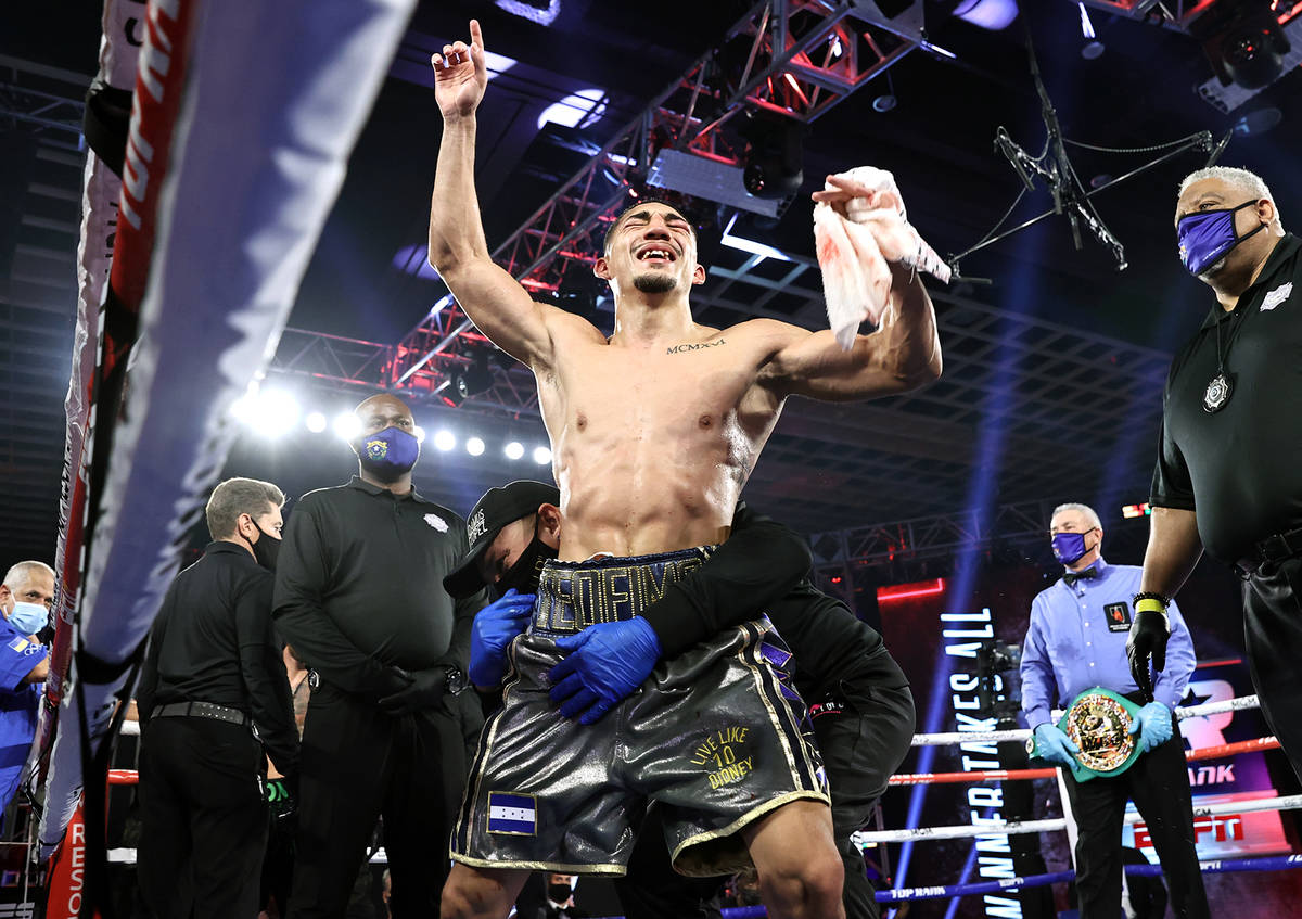 Teofimo Lopez celebrates after winning a unanimous decision over Vasiliy Lomachenko in their li ...