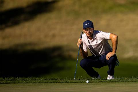 Russell Henley lines up a putt on the 13th green during the third round of the CJ Cup at the Sh ...