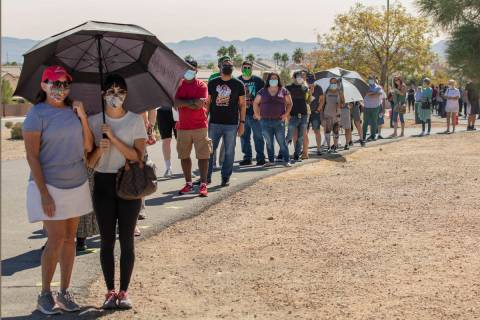 Individuals line up to vote at the event tent located at Desert Breeze Community Center polling ...