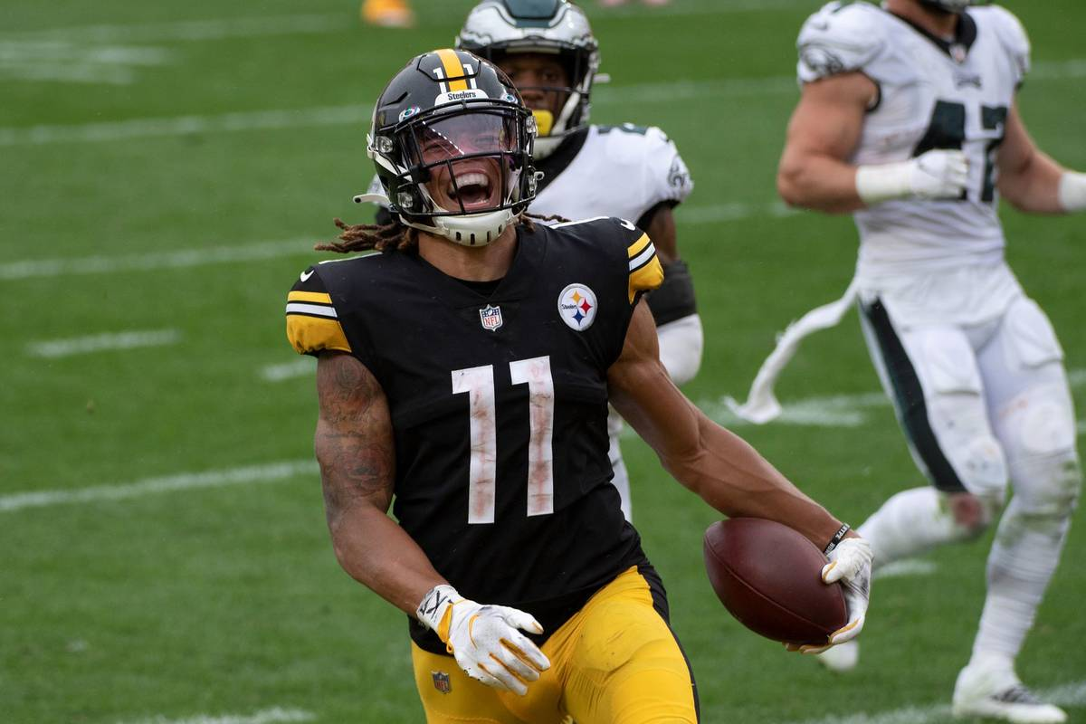 Pittsburgh Steelers wide receiver Chase Claypool (11) reacts as he runs into the end zone for a ...