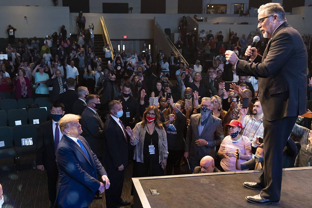 President Donald Trump, lower left, attends church at International Church of Las Vegas, as Pas ...