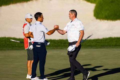 Jason Kokrak, right, celebrates with Xander Schauffele after completing the final round of the ...