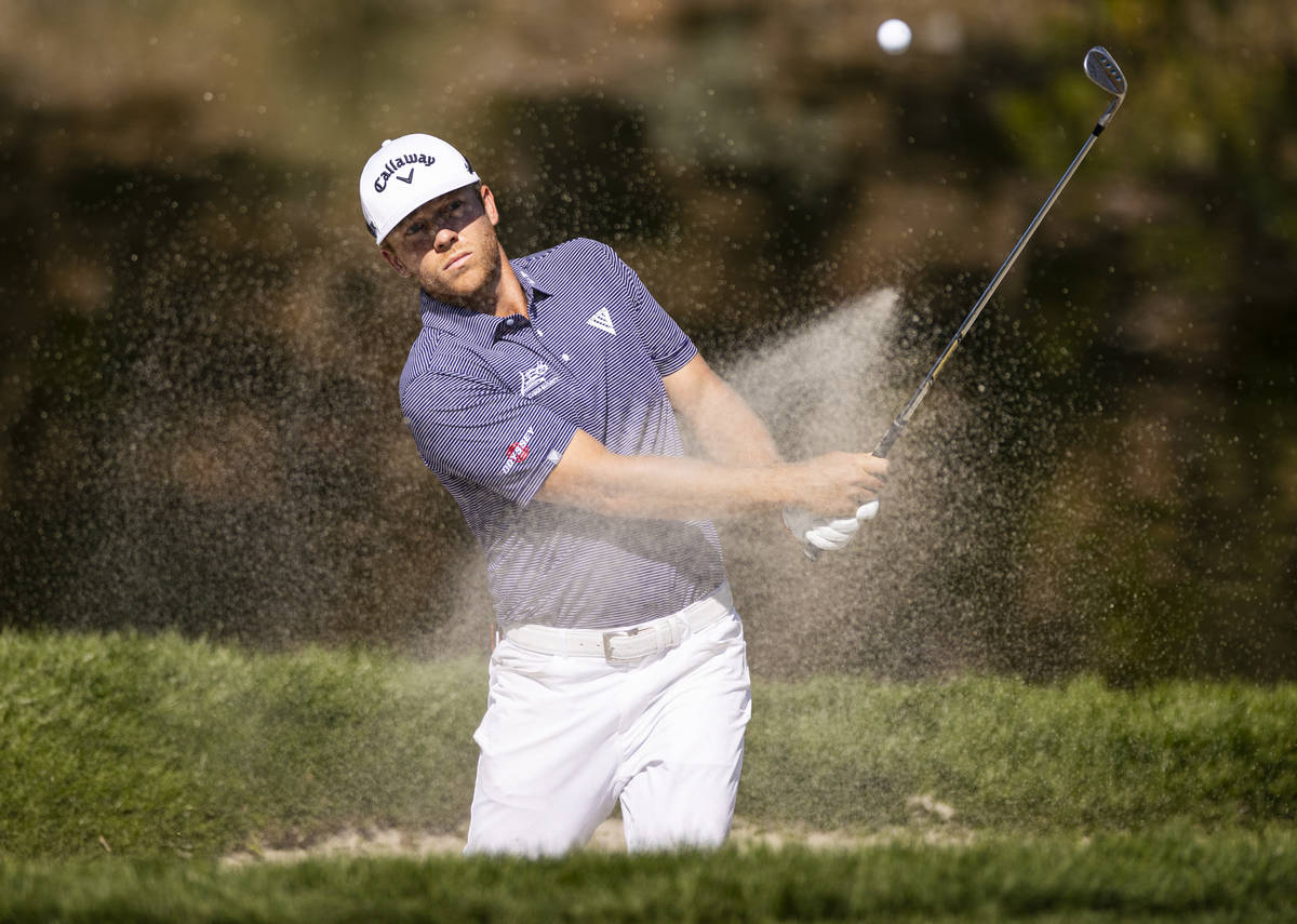 Talor Gooch hits out of the bunker onto the fourth green during the final round of the CJ Cup a ...