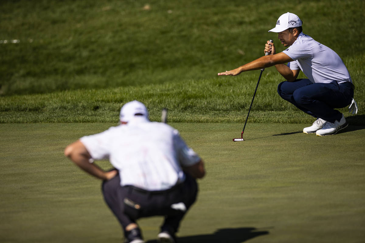 Xander Schauffele lines up a putt on the seventh green during the final round of the CJ Cup at ...