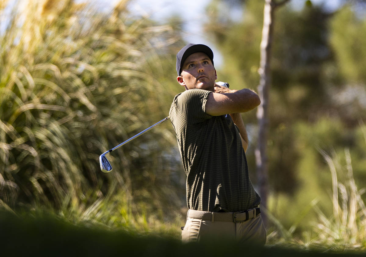 Russell Henley tees off from the eighth hole during the final round of the CJ Cup at the Shadow ...