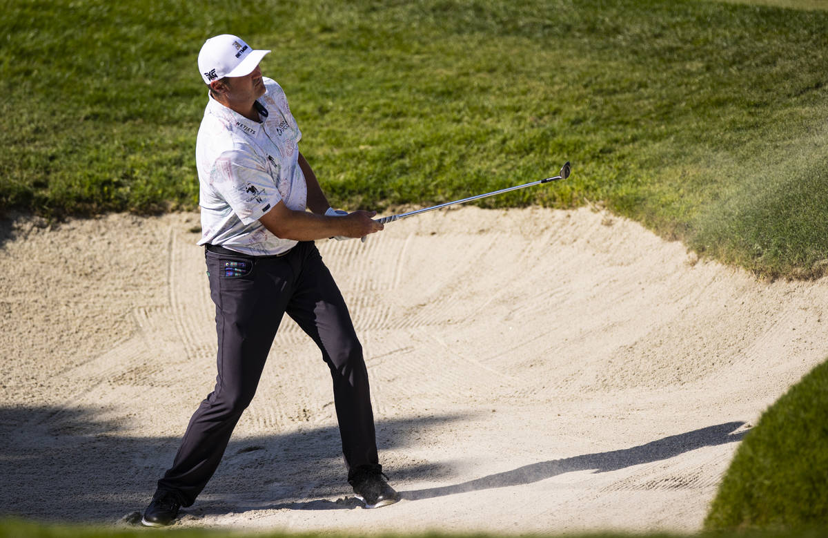 Jason Kokrak hits out of the bunker onto the fourth green during the final round of the CJ Cup ...