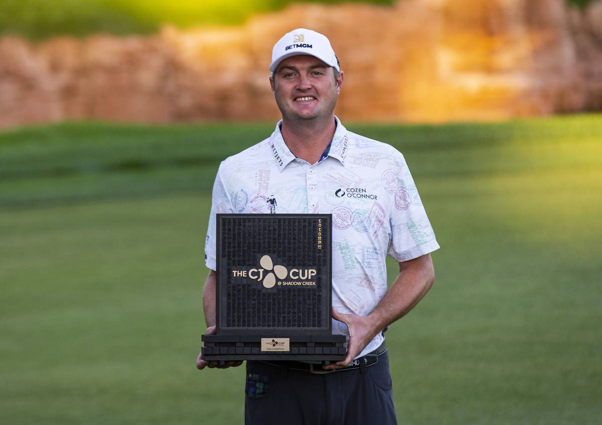 Jason Kokrakʣelebrates with the trophy after winningʴhe CJ Cup at the Shadow Creek ...