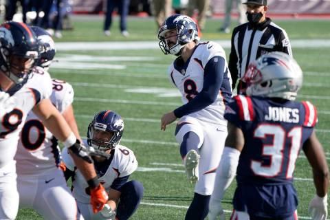Denver Broncos place kicker Brandon McManus (8) follows through on one of his six field goals a ...
