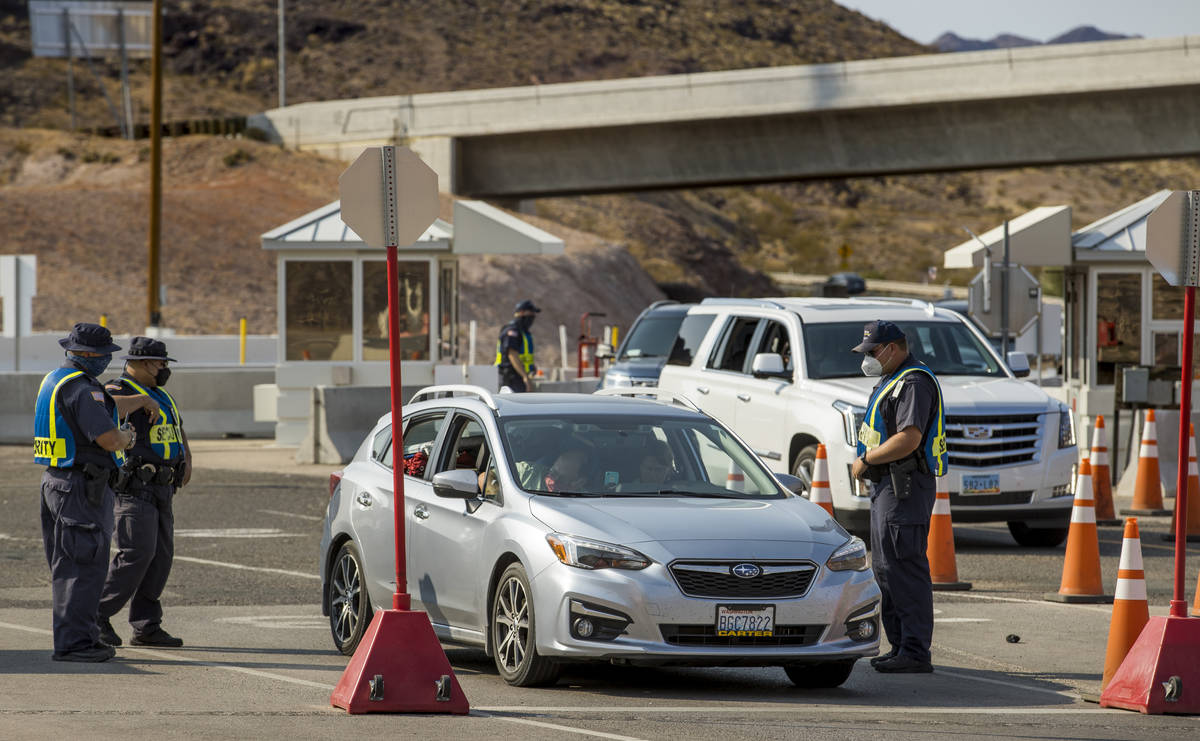 Security is tight as Hoover Dam opens up to the public after being closed for months due to COV ...