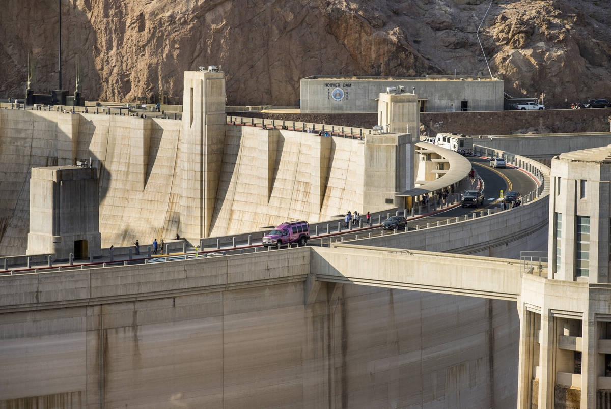Visitors view Hoover Dam, which reopeed to the public after being closed for months due to COVI ...
