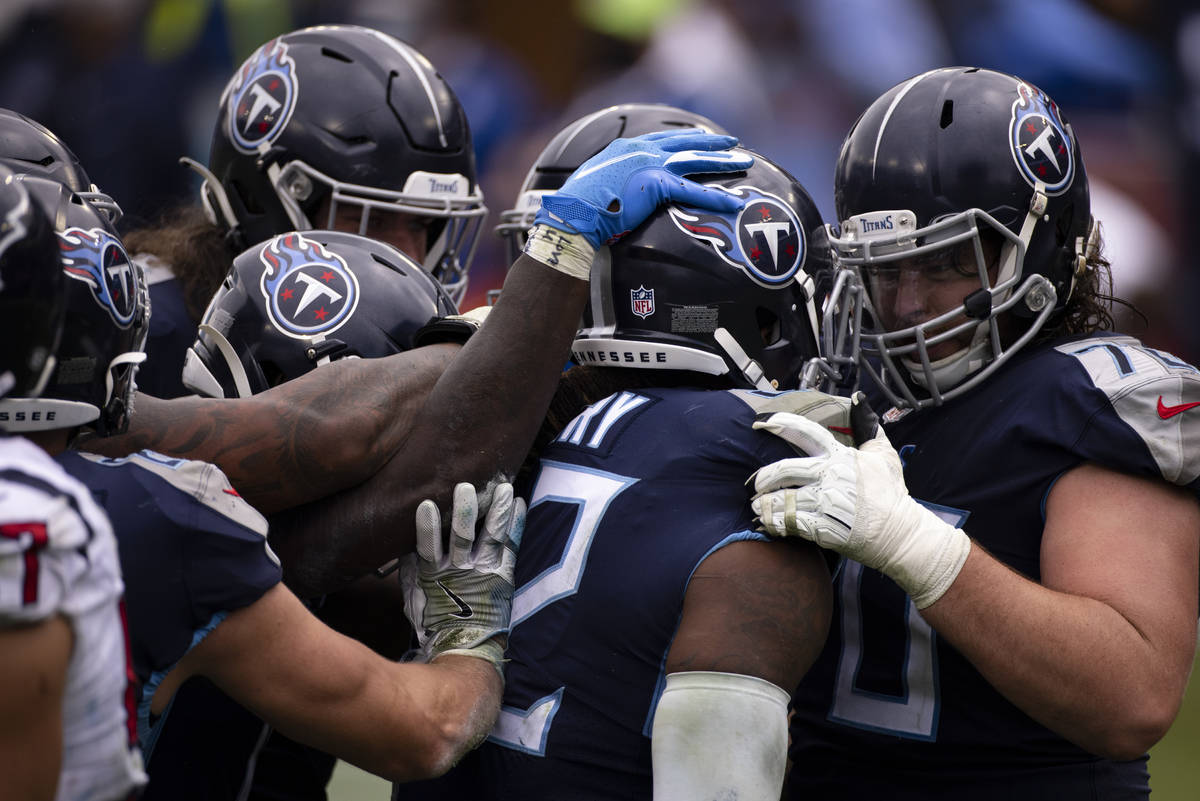 Tennessee Titans offensive tackle Ty Sambrailo (70) congratulates running back Derrick Henry (2 ...