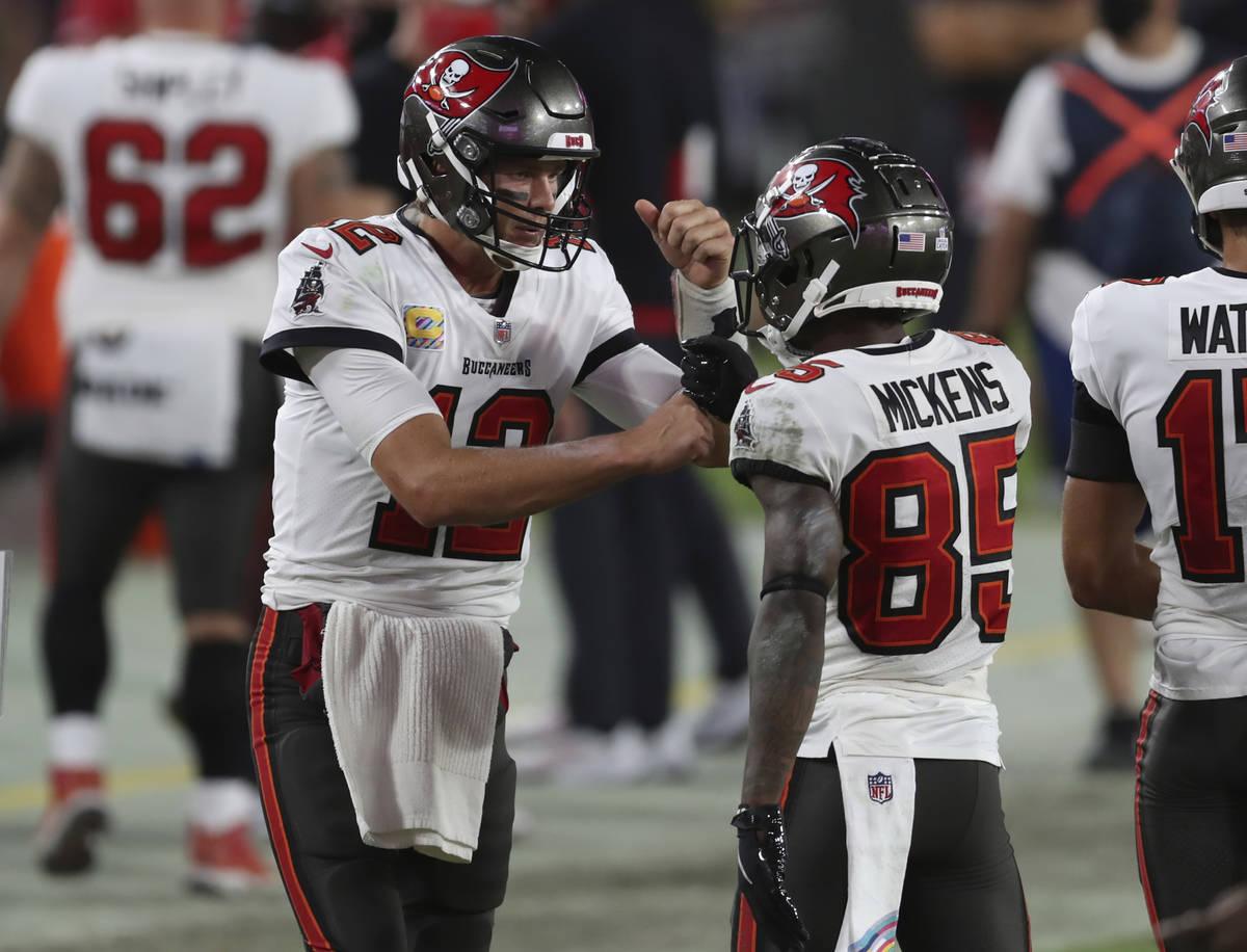 Tampa Bay Buccaneers quarterback Tom Brady (12) celebrates with wide receiver Jaydon Mickens (8 ...