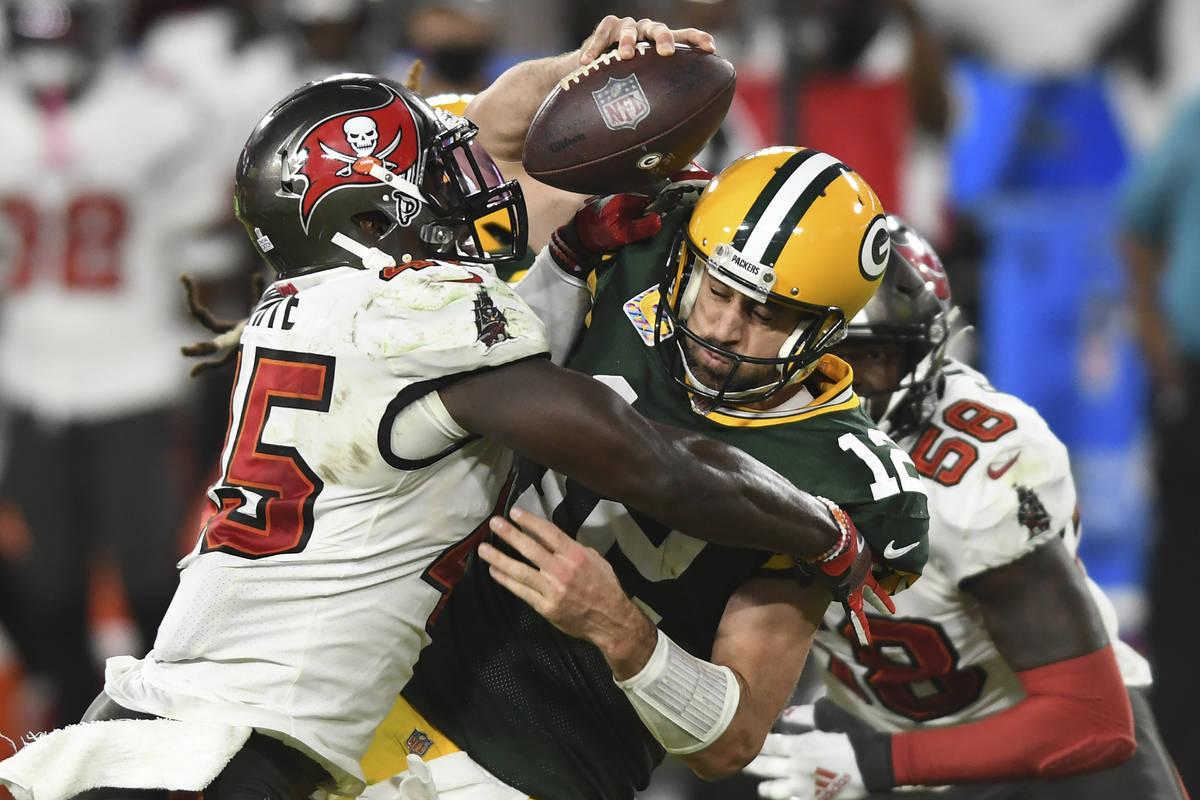 Tampa Bay Buccaneers inside linebacker Devin White (45) sacks Green Bay Packers quarterback Aar ...
