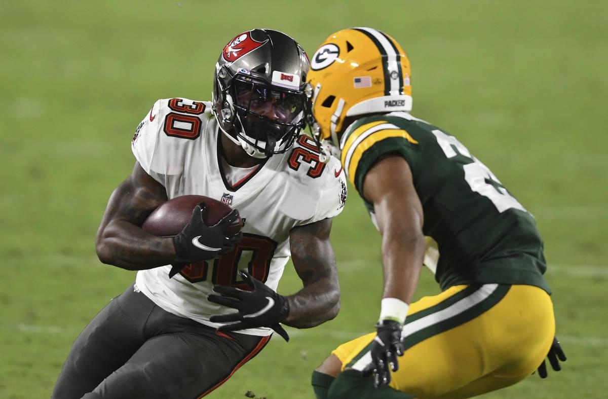 Tampa Bay Buccaneers running back Ke'Shawn Vaughn (30) runs against Green Bay Packers cornerbac ...