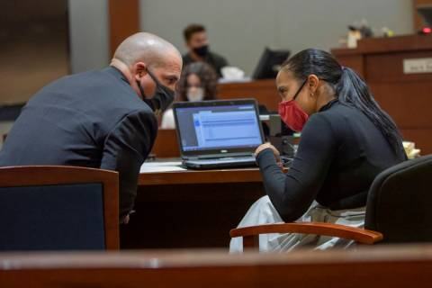 Lead prosecutor John Giordani converses with prosecutor Leah Beverly during a preliminary heari ...