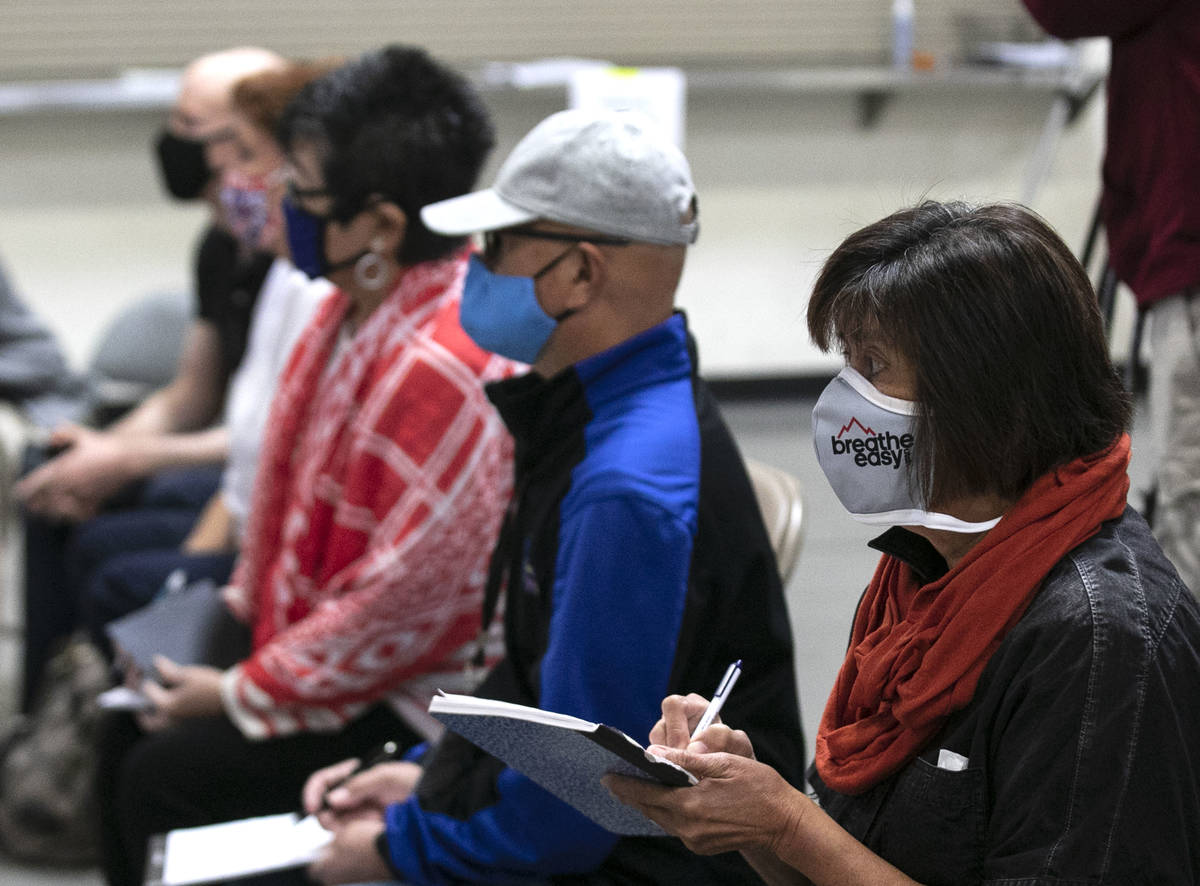 Election observers, Raul Sabido, second right, Michelle Barnes, center, and Donna West, second ...