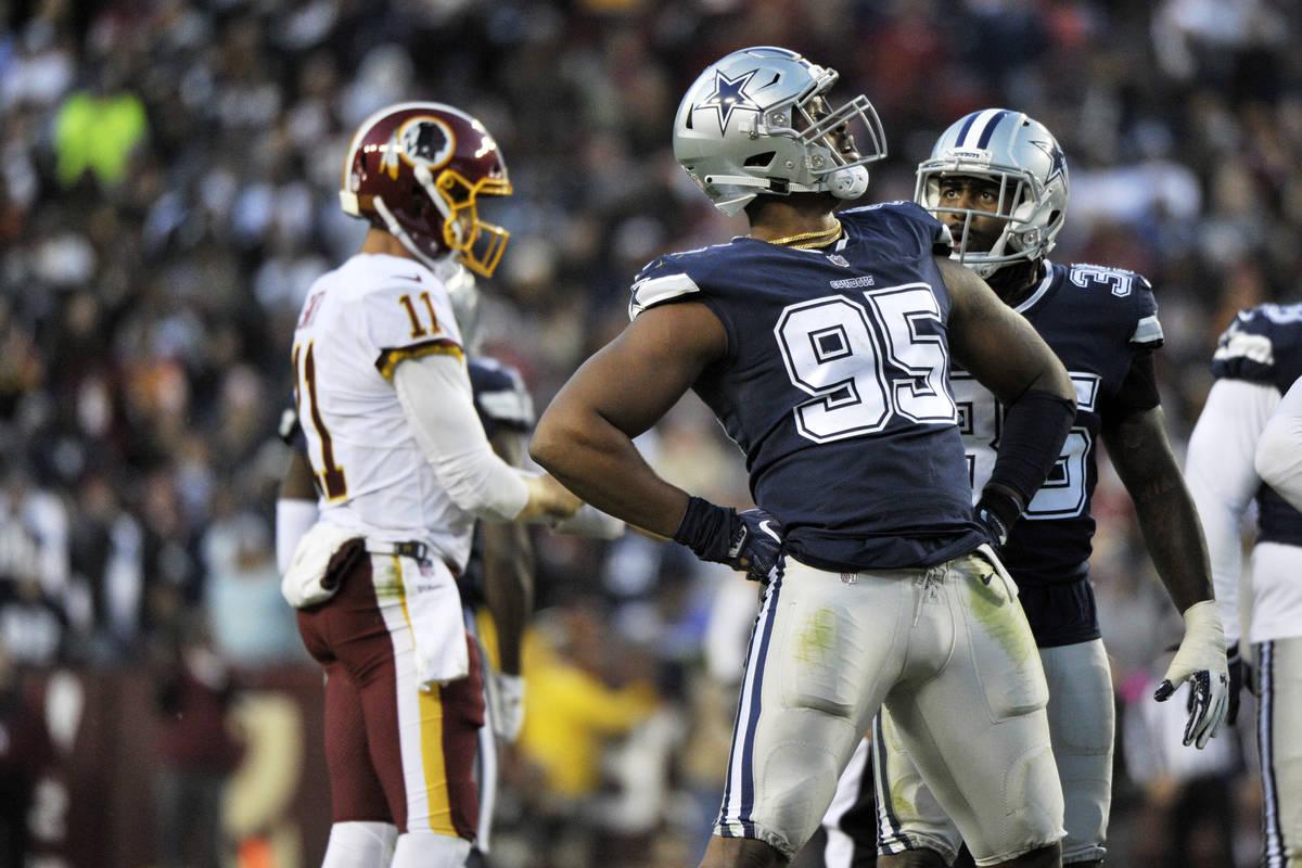 Dallas Cowboys defensive tackle David Irving (95) celebrates a sack during an NFL football game ...