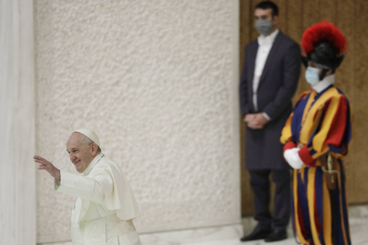Pope Francis waves at the end of his weekly general audience in the Paul VI hall at the Vatican ...