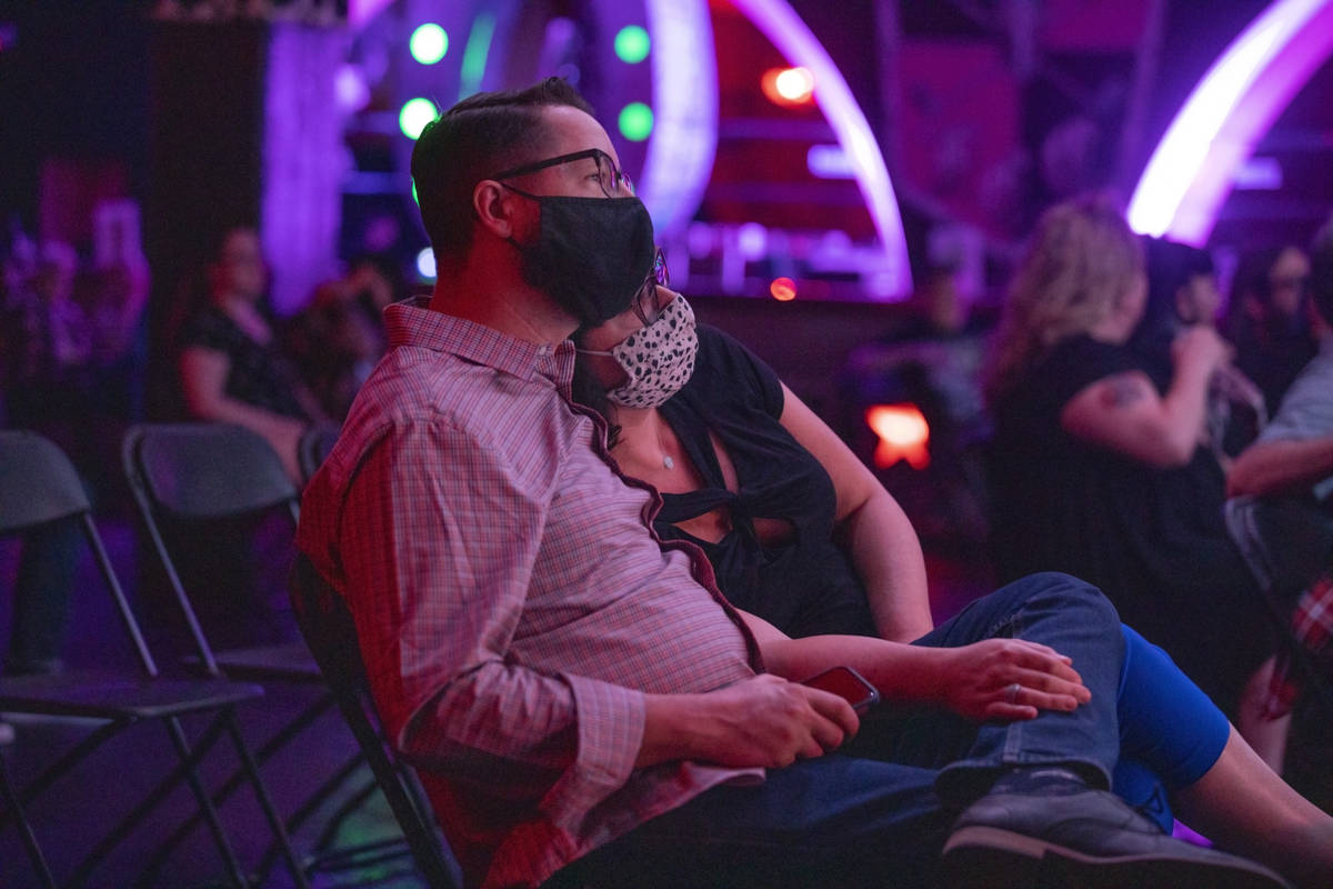 Will and Amy Stutz of Las Vegas listen to Shanda & the Howlers preform as live music return ...