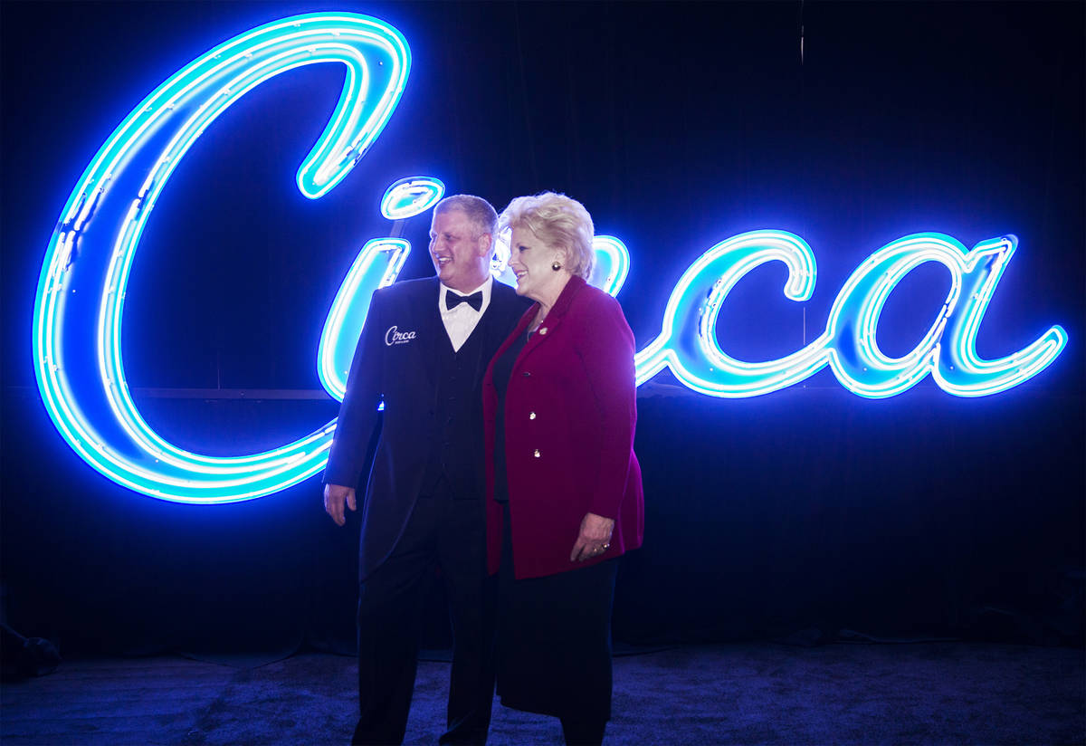 Developer Derek Stevens, left, and Mayor Carolyn Goodman take photos in front of neon signage f ...