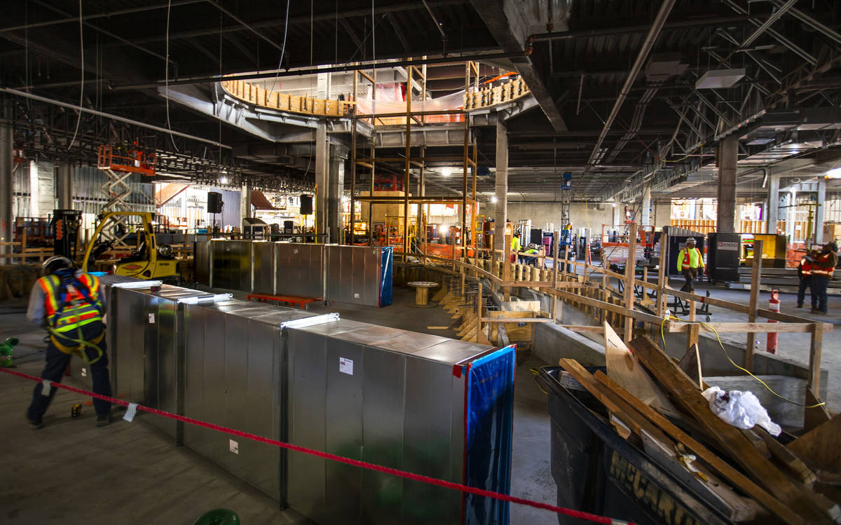 Workers continue to develop the main floor during a construction tour of the Circa on Monday, D ...