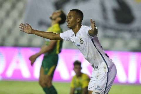 Lucas Braga of Brazil's Santos celebrates scoring his side's second goal against Argentina's De ...