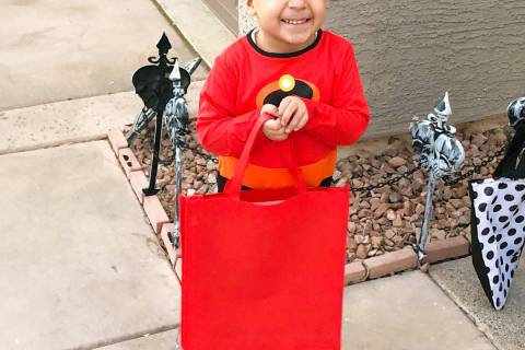 CAMCO Landyn Noghrehkar , 6 , enjoys trick or treating in a northwest valley neighborhood. Thi ...