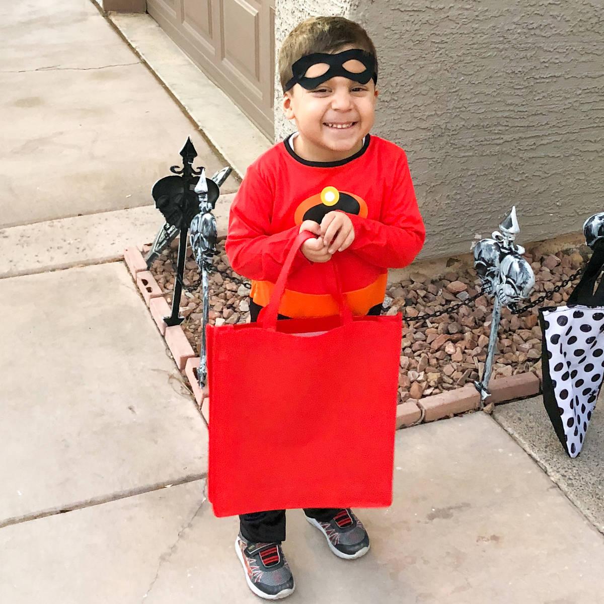 Landyn Noghrehkar , 6 , enjoys trick or treating in a northwest valley neighborhood. This year ...