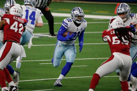 Dallas Cowboys running back Ezekiel Elliott (21) runs against the Arizona Cardinals during an N ...