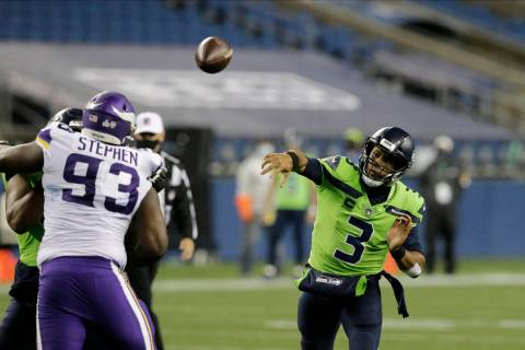 Seattle Seahawks quarterback Russell Wilson throws against the Minnesota Vikings during the sec ...