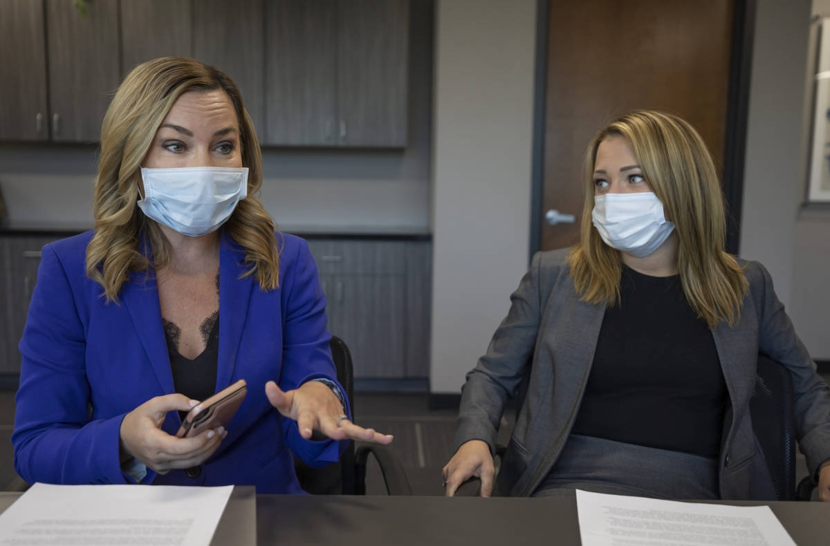 Assistant Federal Public Defenders Maggie Lambrose, left, and Erin Gettel are interviewed on Fr ...