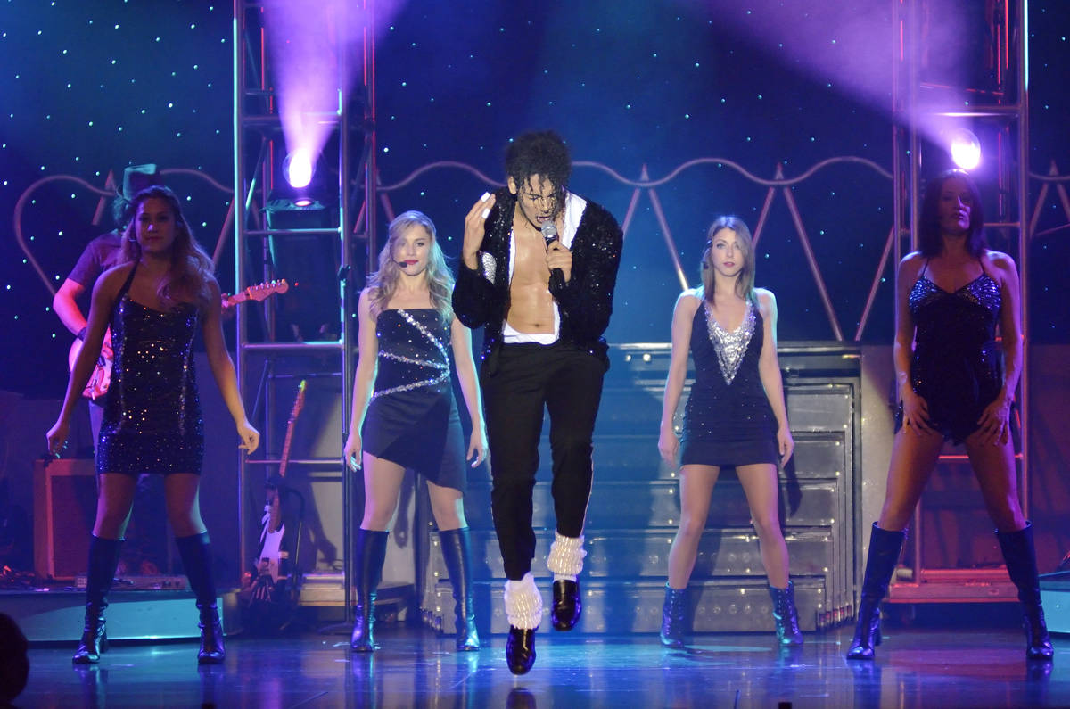 Jalles Franca, center, performs as Michael Jackson with, from left, Brianne Verzosa, Giovanna A ...