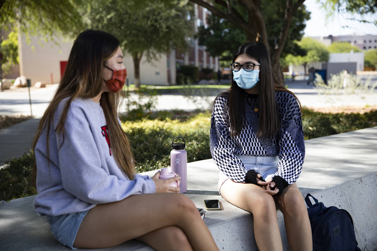 Michelle Kim, a pre-nursing sophomore, left, hangs out with her friend Savannah Judnich, right, ...