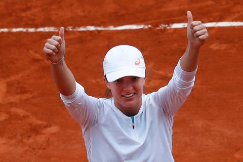 Poland's Iga Swiatek celebrates winning the final match of the French Open tennis tournament ag ...