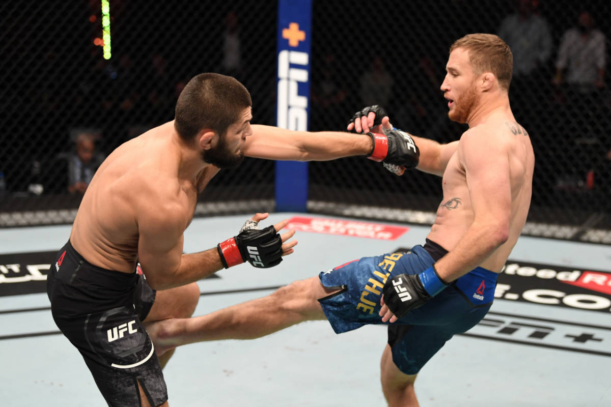 ABU DHABI, UNITED ARAB EMIRATES - OCTOBER 25: (L-R) Khabib Nurmagomedov of Russia battles Just ...