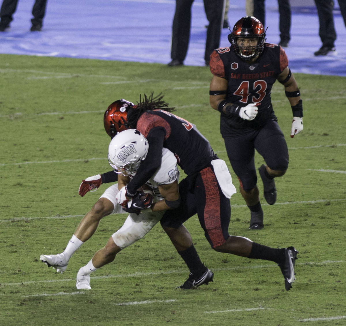 UNLV's Jacob Gasser is tackled by San Diego State's Dwayne Johnson Jr. during Saturday's Mo ...
