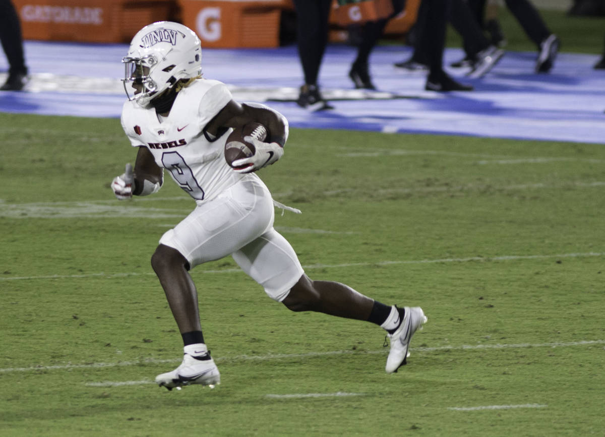 UNLV's Tyleek Collins runs the ball on a punt return during Saturday's Mountain West confere ...